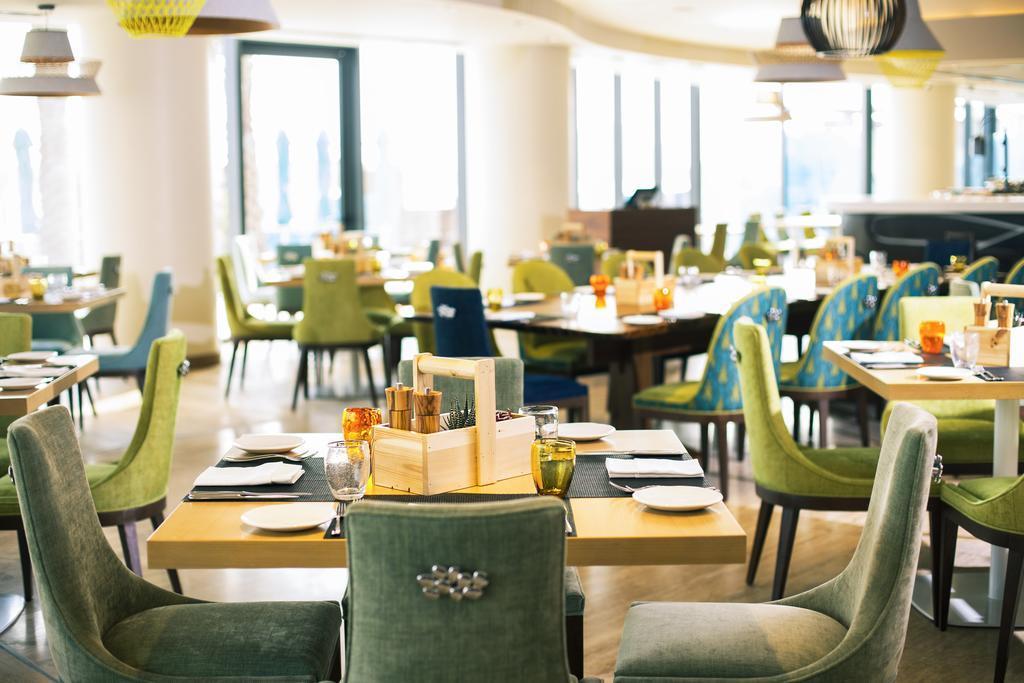 Отель ретрит пальм дубай работа в таллине эстония